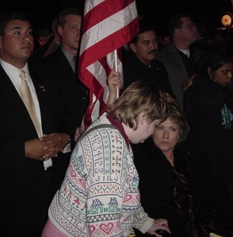 Sheela Gunn and HolLynn D'Lil.  One of the security police behind us is tugging on the flag to make it harder to hold up.